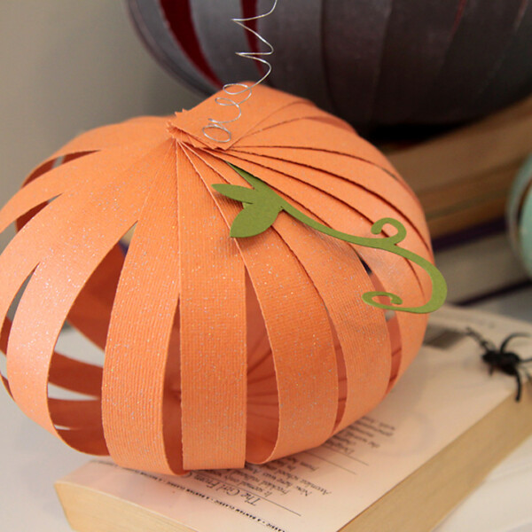 Pumpkin craft made from strips of orange paper