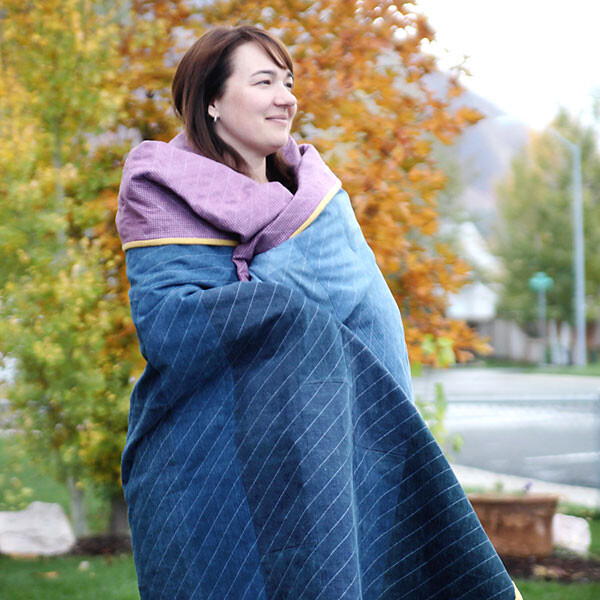 A person wrapped in a demin quilt