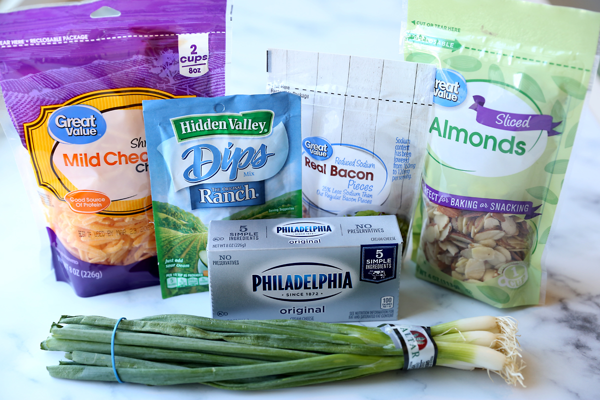 Cheese ball ingredients: cream cheese, cheddar, green onions, bacon bits, ranch dressing mix, almonds