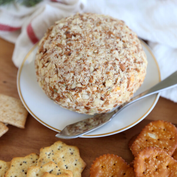 Bacon ranch cheeseball surrounded by crackers