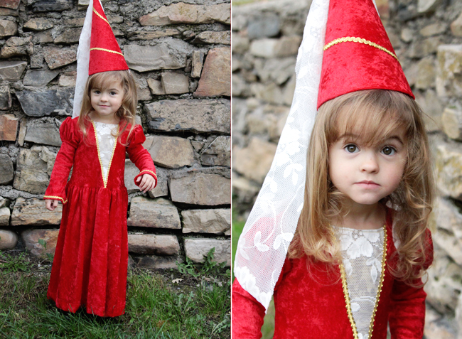 little girl in a red medieval princess costume