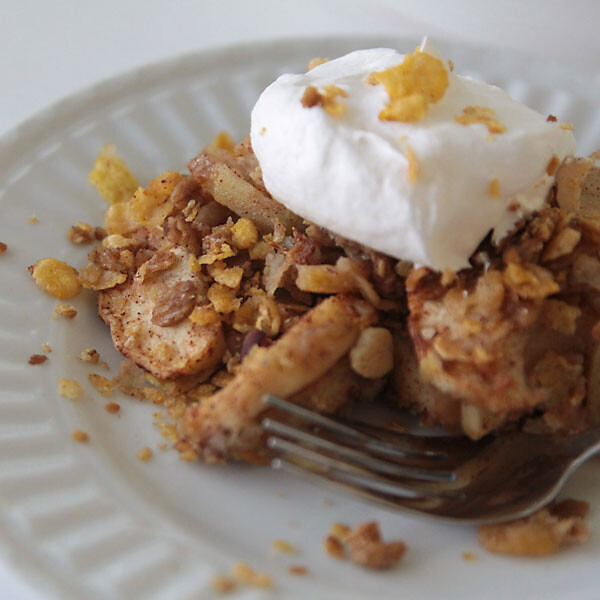 healthy apple crisp on a plate with whipped topping