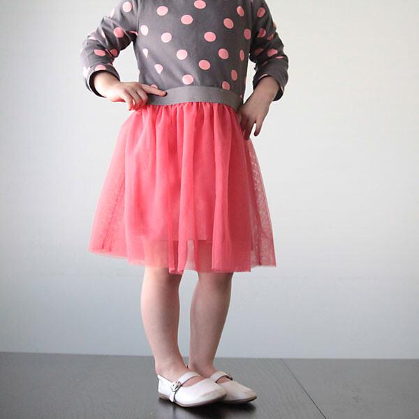 A girl wearing a pink dress