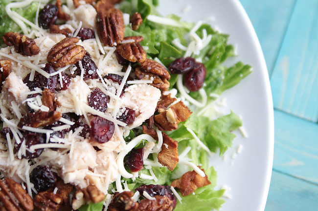 incredible main dish salad recipe with chicken, bacon, cheese, craisins, pecans, and a delicious homemade dressing