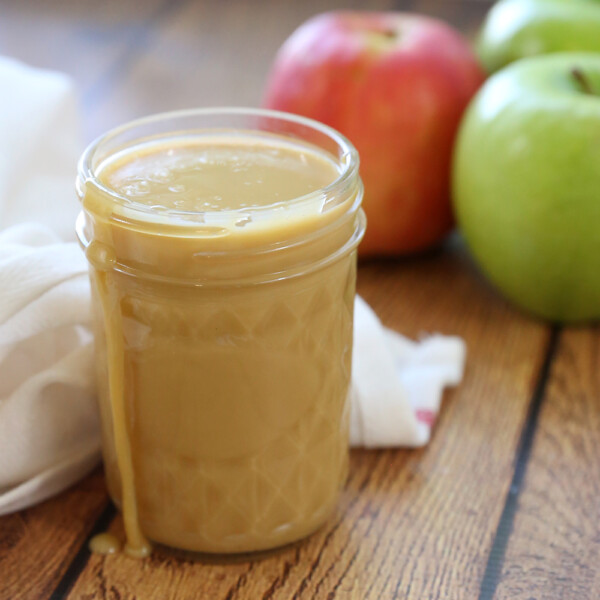Sweetened condensed milk caramel in a jar with apples
