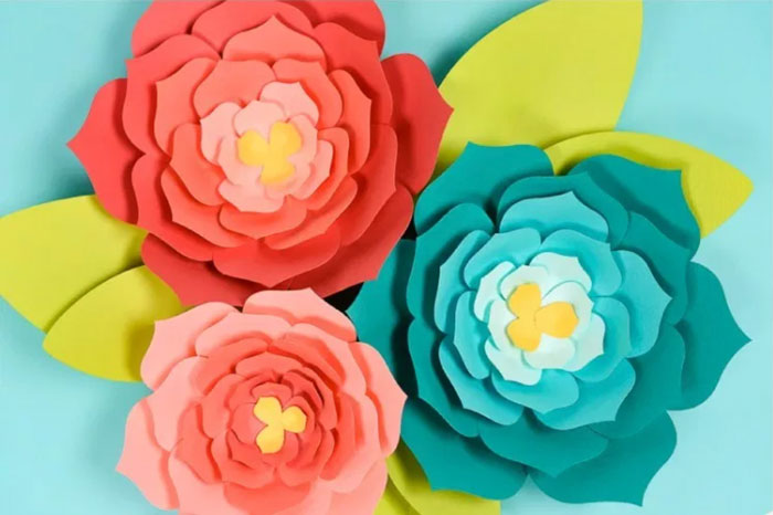 Giant paper flowers with an ombre color effect.