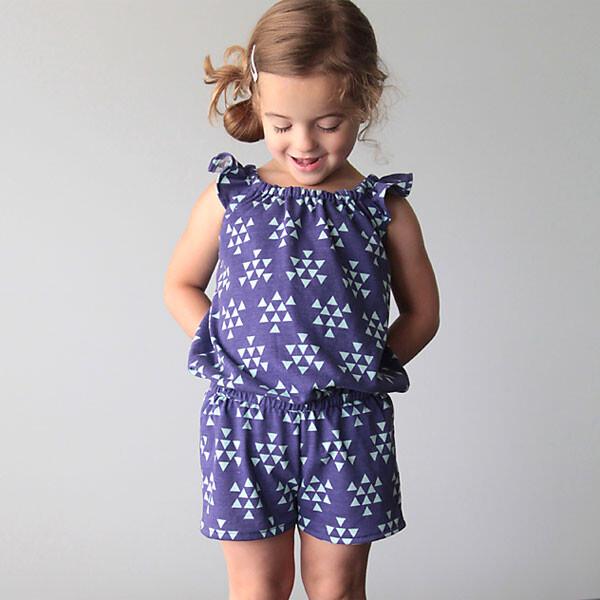 A little girl in a blue flutter sleeve romper