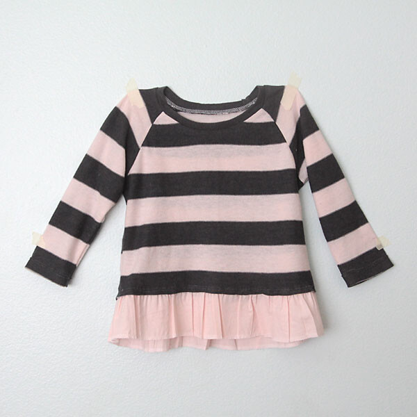 A striped girls top with a ruffled hem