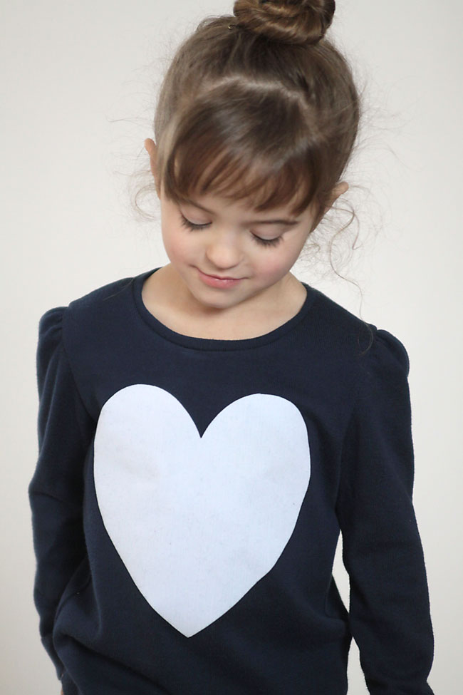 super easy DIY big heart sweater - cute! this would be fun for Valentine's day.