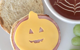 """Fun, easy dinner idea for Halloween night - use pumpkin cookie cutters to make a cheese pumpkin for a ham + cheese sandwich. Kids can even """"carve"""" a jack-o-lantern face on the pumpkin with a toothpick!"""