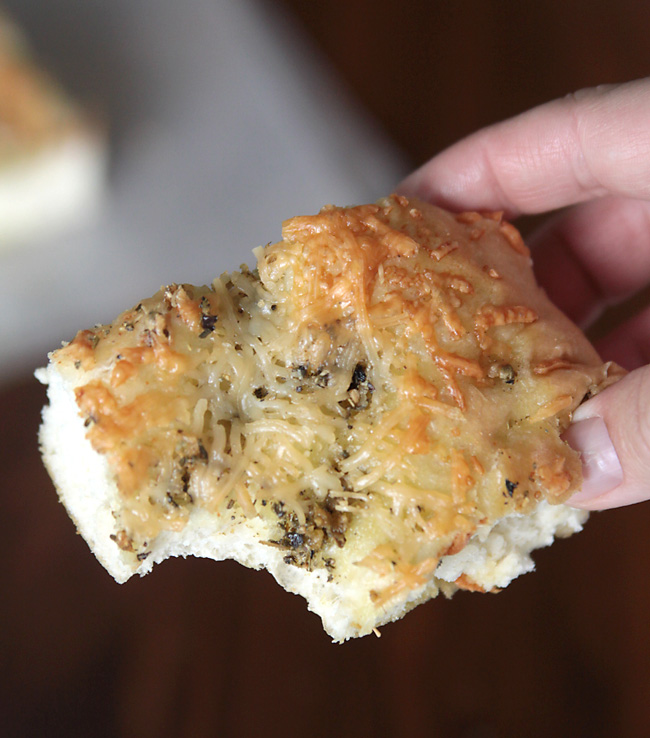 This focaccia bread is super easy to make because it starts with frozen bread dough, but it tastes amazing thanks to garlic and herbs. Best easy bread recipe ever!