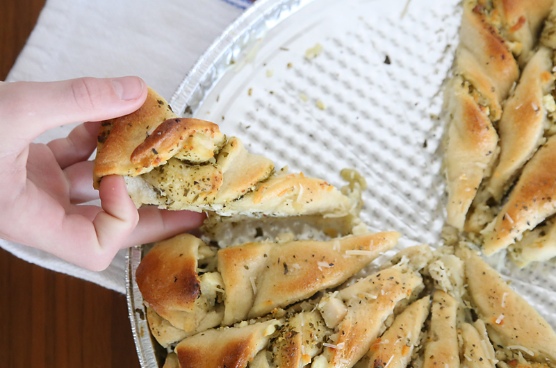 Pesto chicken tear & share is an easy stuffed bread recipe that's so delicious! Perfect as an appetizer or main dish. It's fast because it starts with refrigerated dough!