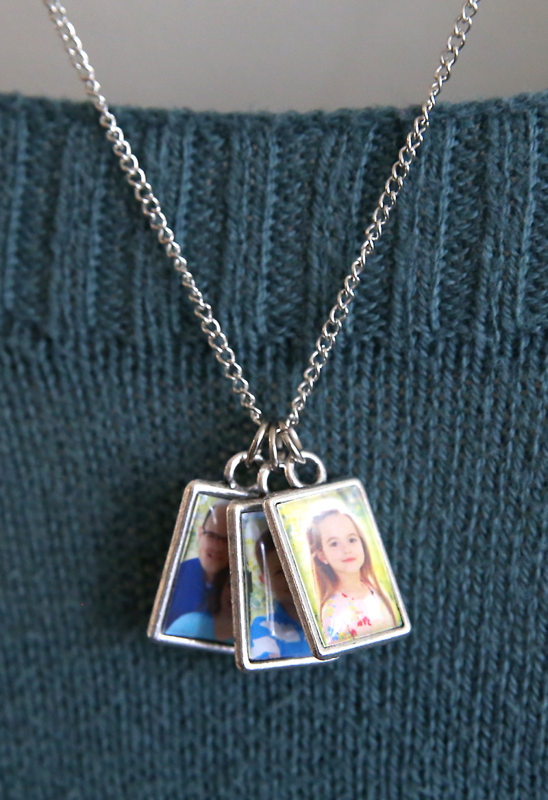 Turn your favorite photographs into a picture necklace! DIY Photo necklaces are a unique handmade craft and gift idea. Use this easy photo necklace jewelry making tutorial to make one of a kind photo pendant keepsakes your family and friends will treasure.