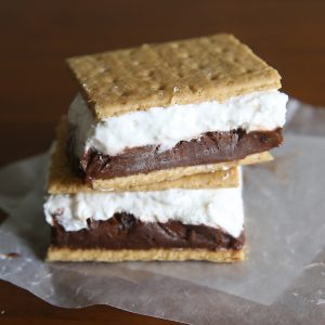 Frozen s'mores! Layers of chocolate pudding and marshmallow cheesecake sandwiched between graham crackers and frozen for the perfect summer treat. Super easy recipe!
