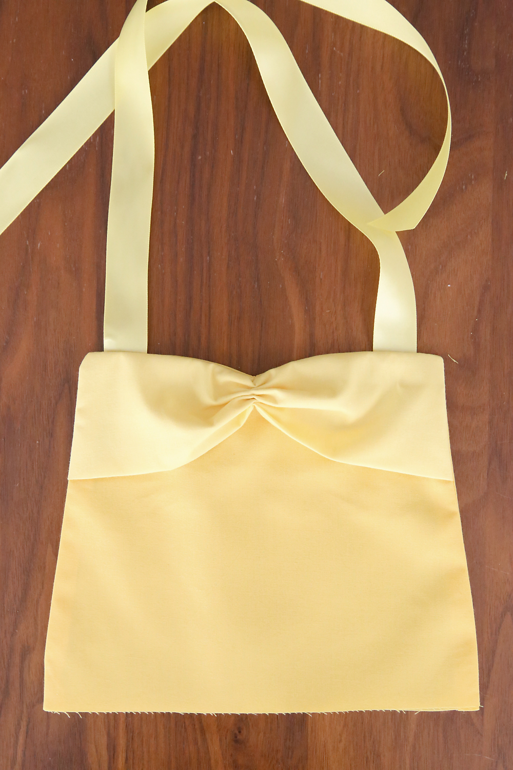 So cute! This easy to sew Belle (Beauty and the Beast) princess dress up apron would be the perfect handmade gift for a little girl. Free PDF sewing pattern plus lots of other princess dress up aprons.