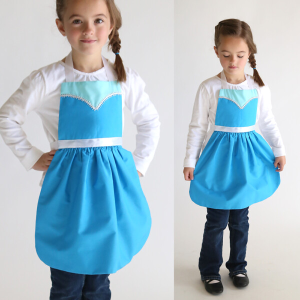 A girl in a blue dress up apron that looks like Elsa princess from Frozen