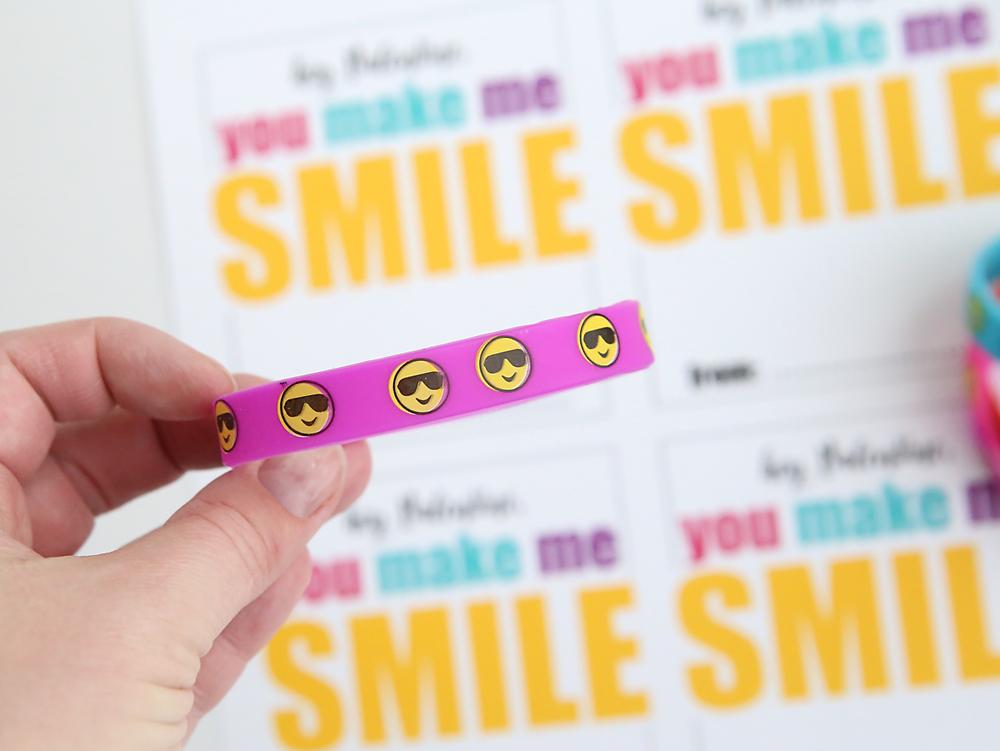 Cute free printable DIY Valentine's Day card with emoji bracelets. Such a fun non-candy Valentine idea!