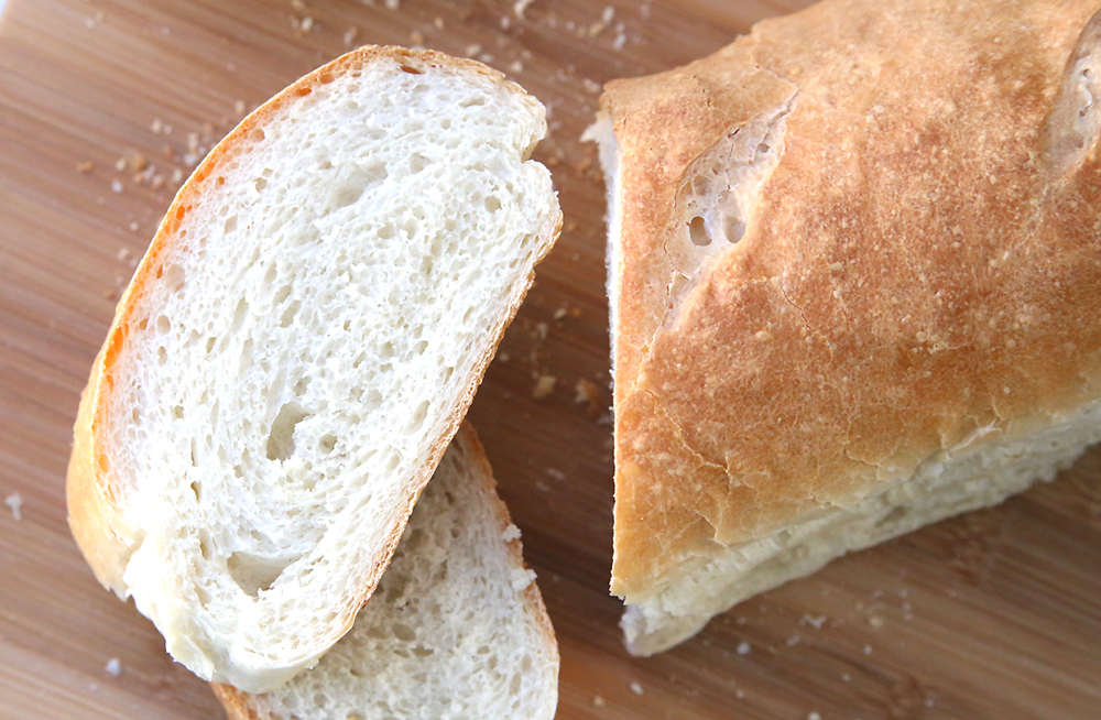 Learn how to make amazing homemade french bread with this easy recipe and video tutorial. It's so delicious! And try the herbed garlic butter too