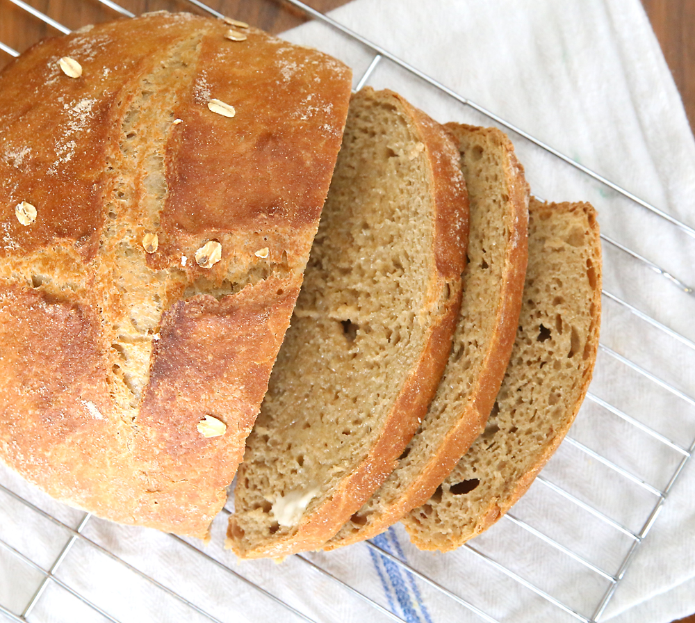 If you think you can't make bread, this recipe is for you! Super easy 5 ingredient no-knead whole wheat artisan bread. Easy, healthy, and delicious!