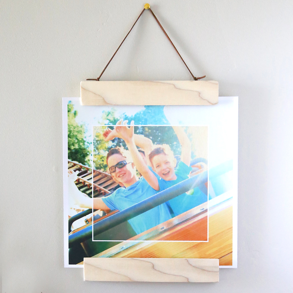 Learn how to make this DIY modern wood + magnet hanging photo frame - it's really easy to make and super easy to swap out photos! Also, learn how to add an effects collage to your photos with Photoshop Elements 15.