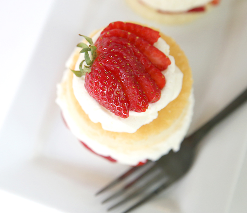 Not your usual strawberry shortcake! This version is not only gorgeous, it tastes amazing. Soft, rich cake plus a white chocolate cream make it the best strawberry shortcake recipe ever! (Plus is starts with boxed mixes so it's easy!)