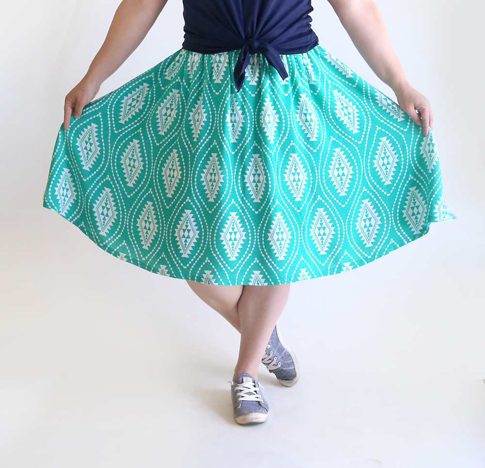 Learn how to sew the perfect gathered skirt for summer! This version has a flattering flat front waistband and a comfy elastic back waist - best of both worlds! Easy women's sewing tutorial.