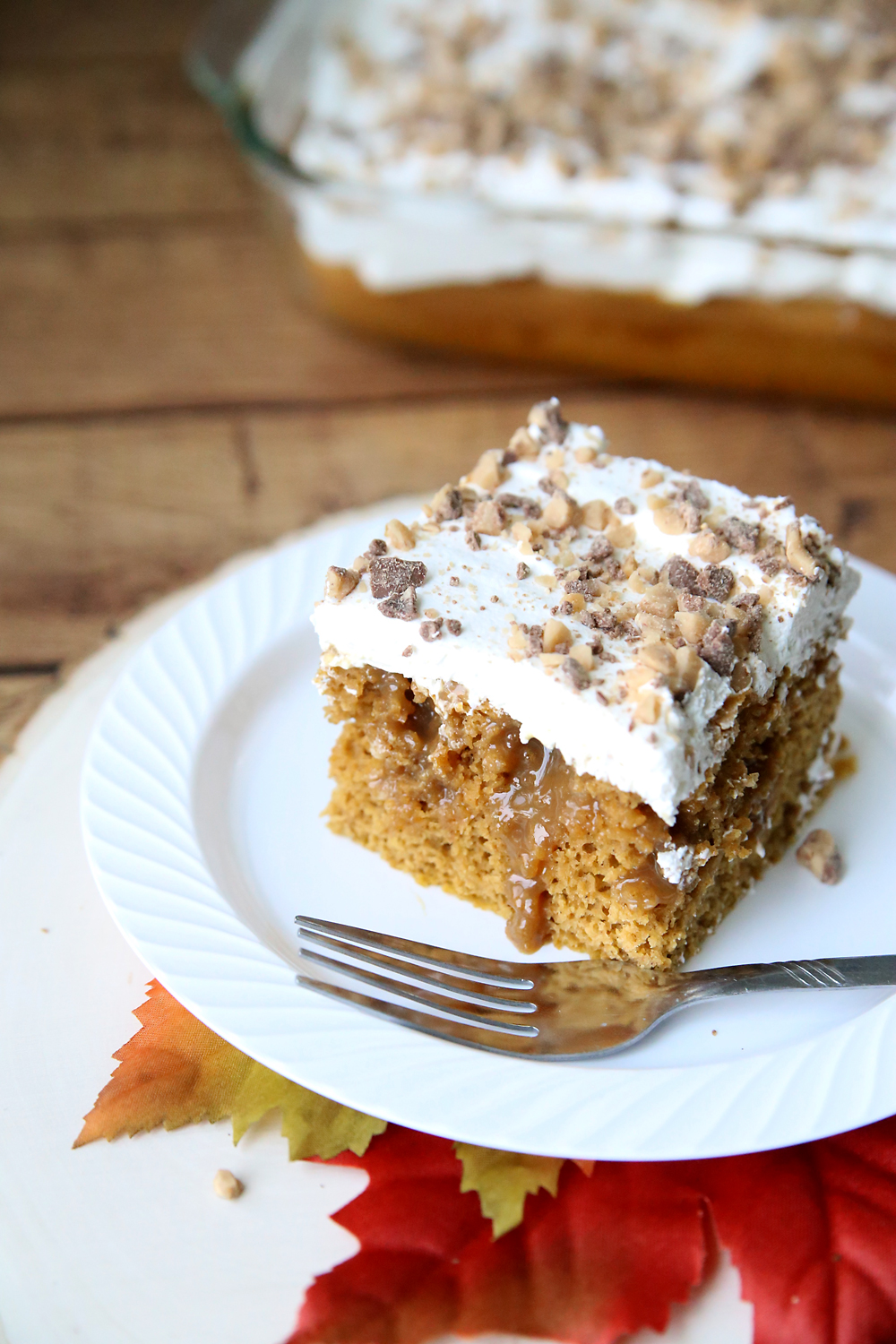 Caramel pumpkin poke cake is the perfect fall dessert. Quick + easy recipe.