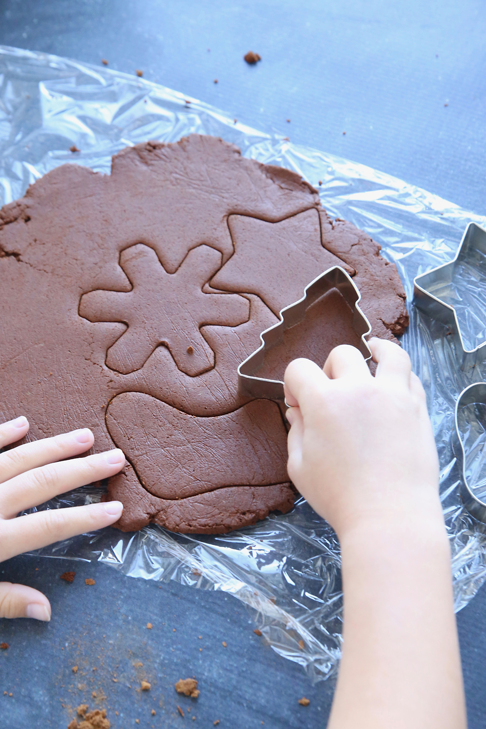 Use cookie cutters to cut out the cinnamon ornaments.