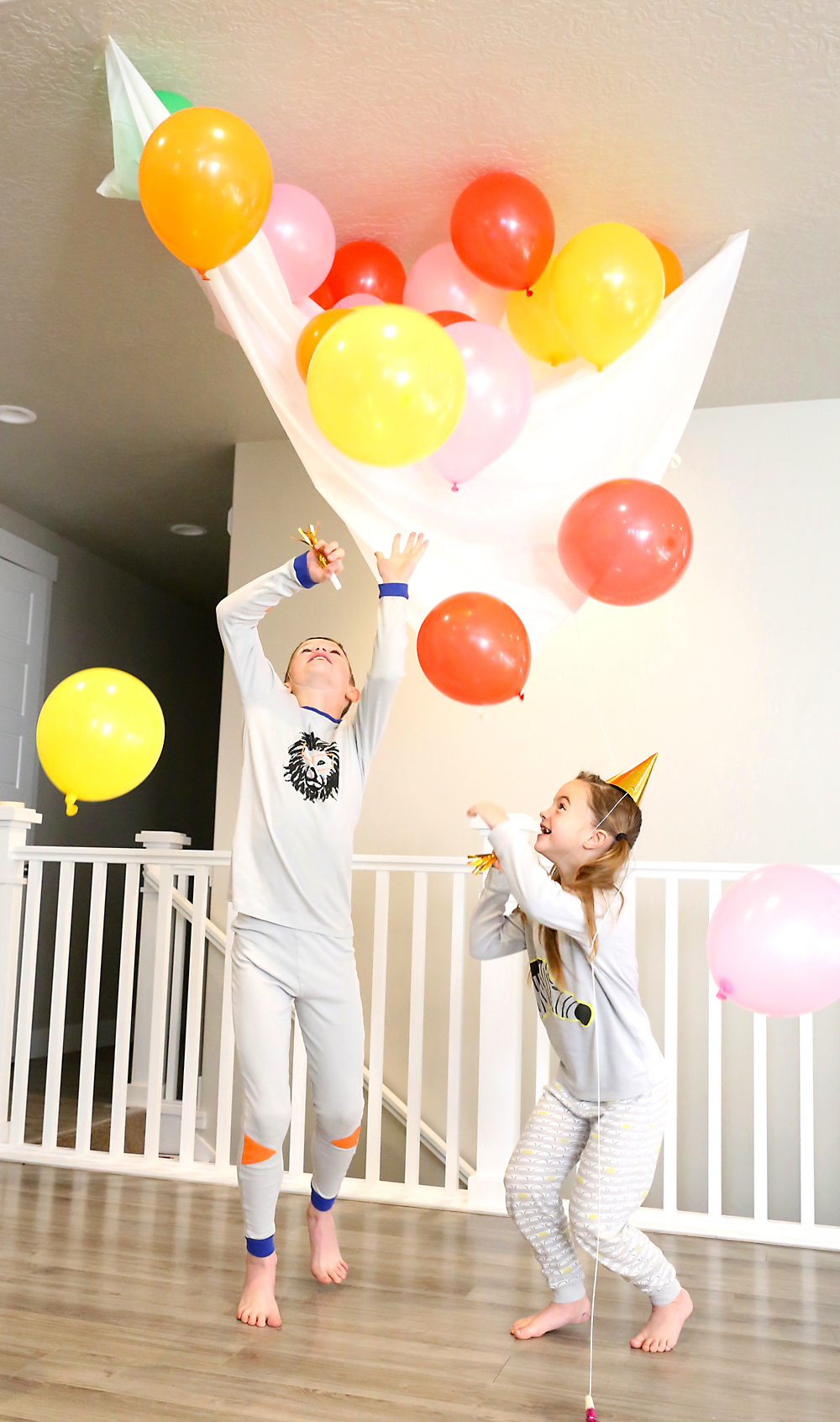 "So fun! Make an easy balloon drop for New Year's Eve with supplies from the dollar store - then drop it whenever you want it to be ""midnight""! Great idea for New Year's Eve at home with kids."