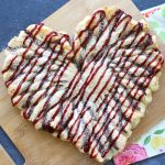 This raspberry nutella puff pastry heart is an easy Valentine's dessert everyone will love! Quick and easy recipe.