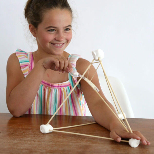 Girl playing with marshmallow catapult