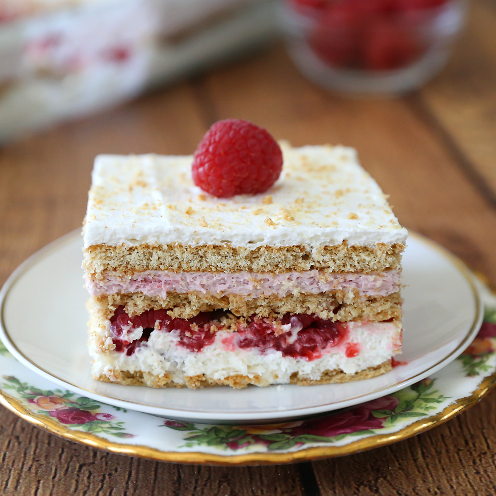 Raspberry Cheesecake Icebox Cake is your new favorite summer dessert! This easy no bake dessert features fresh raspberries and a delicious cheesecake filling.