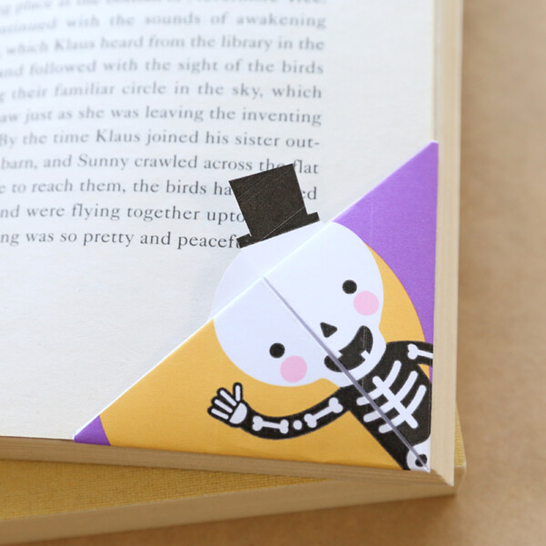 Halloween corner bookmarks with a skeleton on it