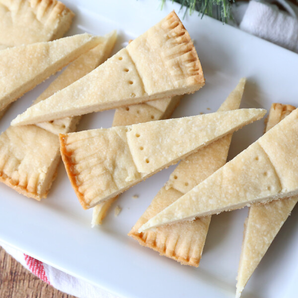 Wedge shaped shortbread cookies on a plate