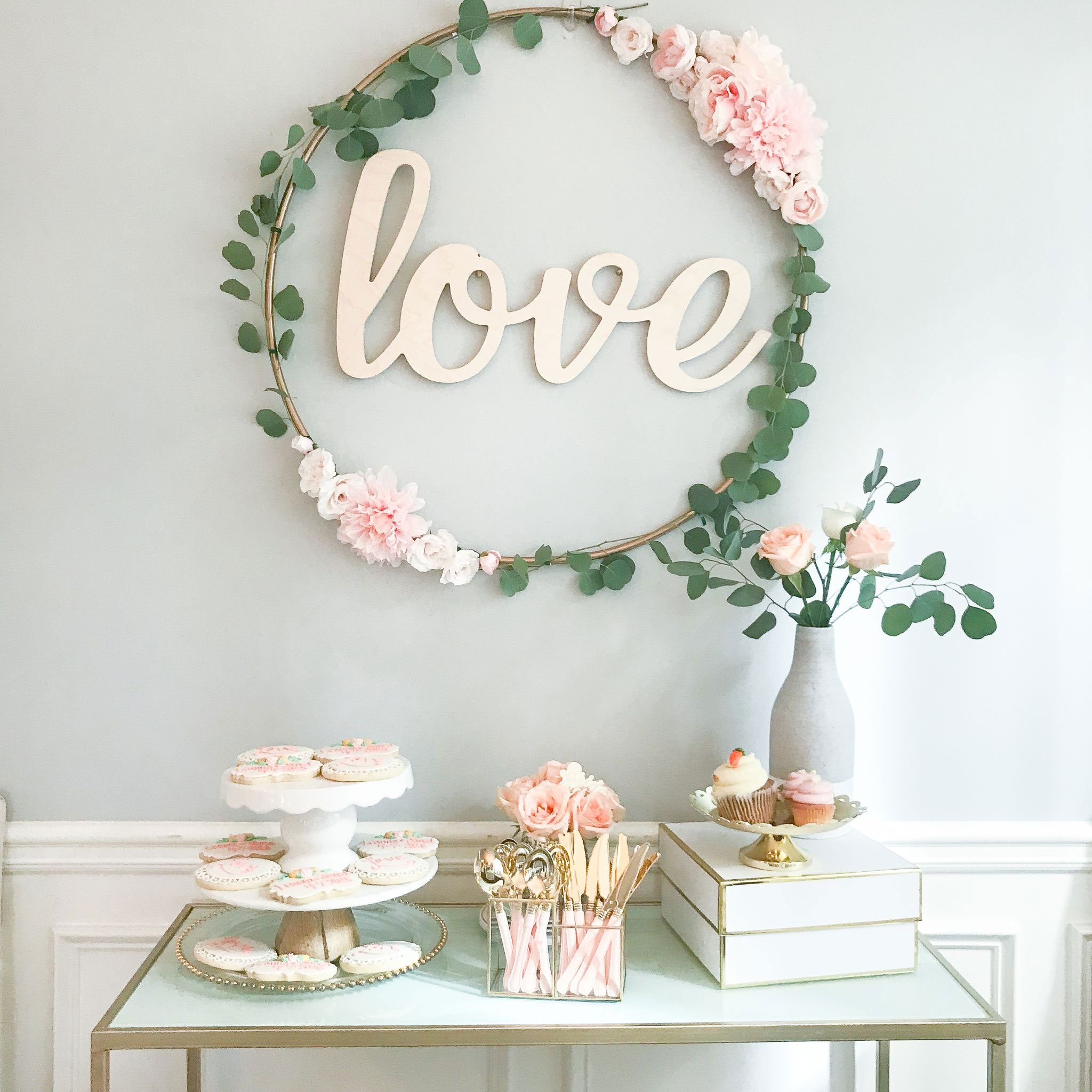 "Large hula hoop wreath with ""love"" letters"