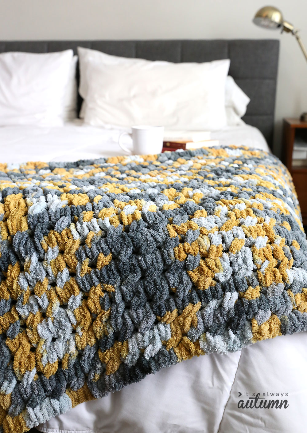 It's super easy to make this pretty cable knit blanket using looping yarn! You can finger knit without needles or any knitting experience.