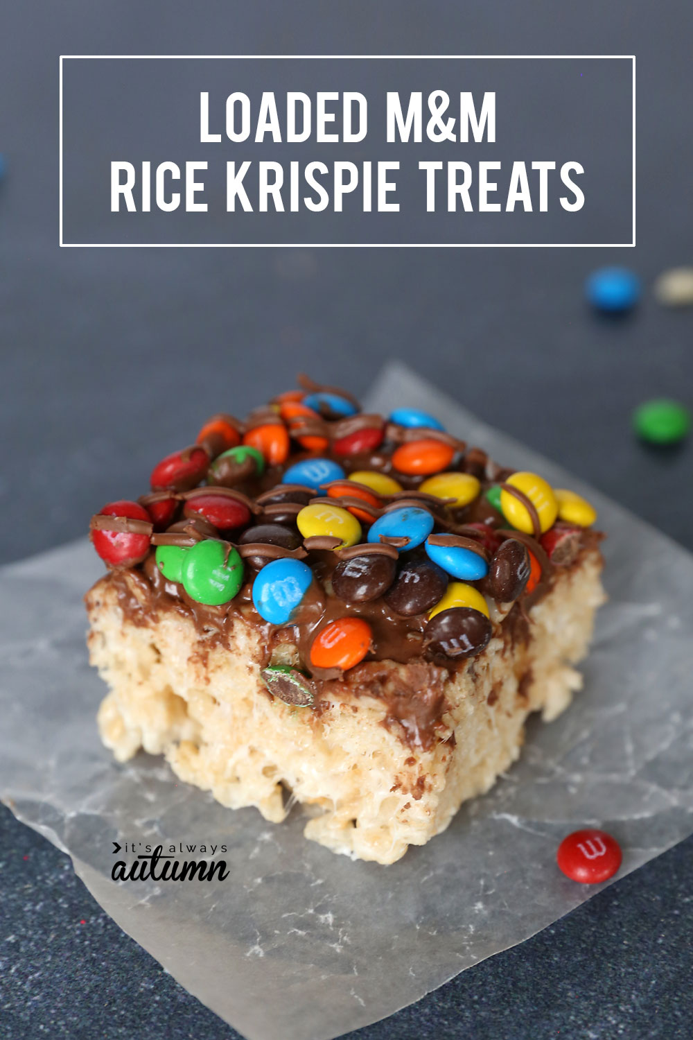These loaded M&M rice krispie treats are delicious! Extra chewy and full of chocolate flavor. Click through for the easy recipe.