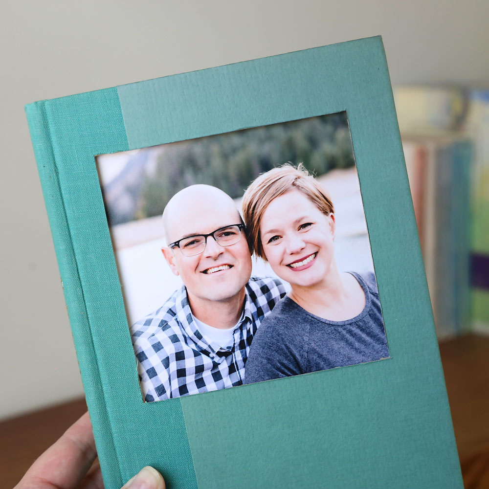 Turn an old book into a cool DIY book picture frame. It doesn't ruin either the book or the photo, and it's easy to swap out photos in seconds!