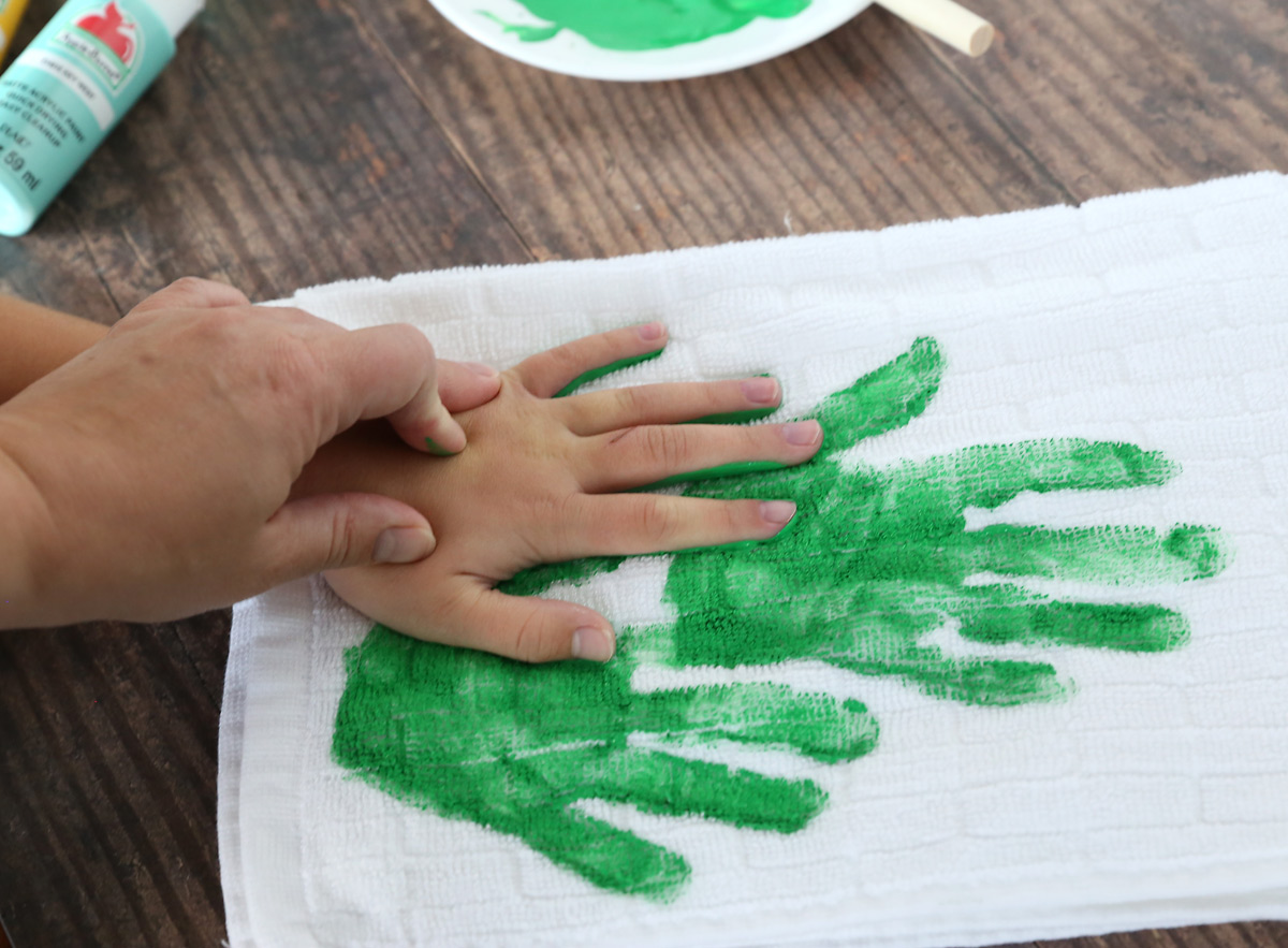 Three handprints to make a Christmas tree shape