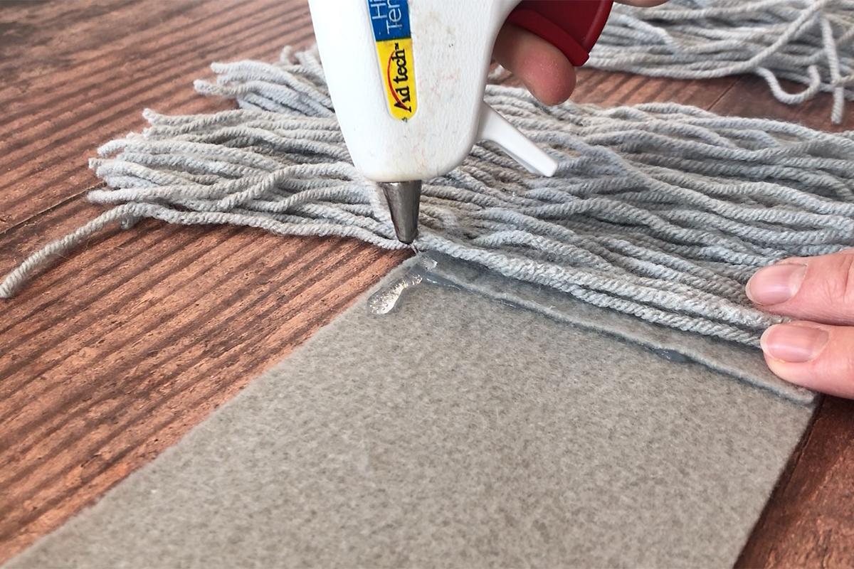 Glue yarn to felt
