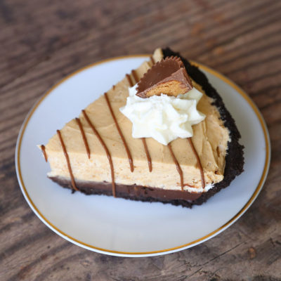 Pie with Oreo crust, chocolate ganache, and peanut butter cream layers