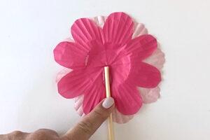 Gluing wood skewer to back of cupcake liner flower