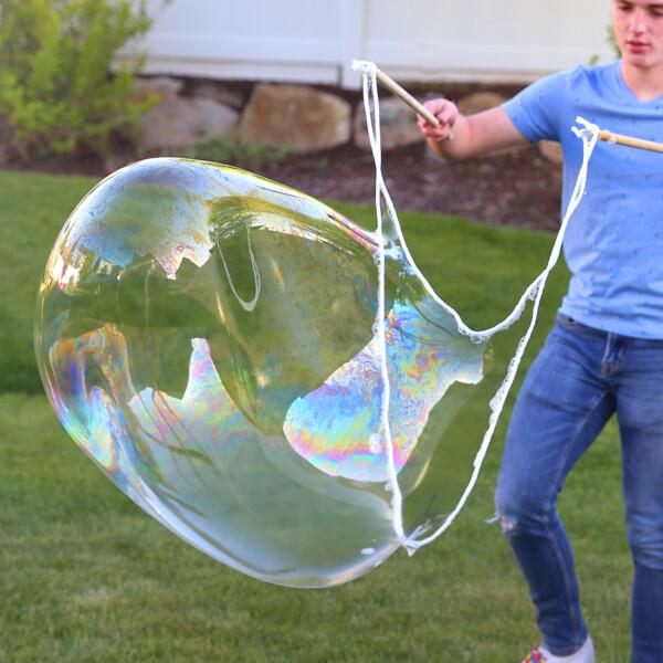 Boy blowing large bubble