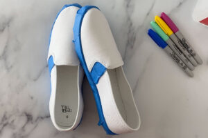 Pair of white canvas shoes with soles taped off