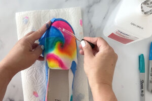 Dropping alcohol onto shoe to make sharpie designs run and blend