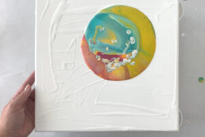 Pool of paint on a white canvas