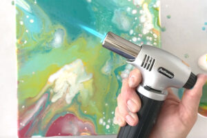 Kitchen blow torch used to pop bubbles in paint